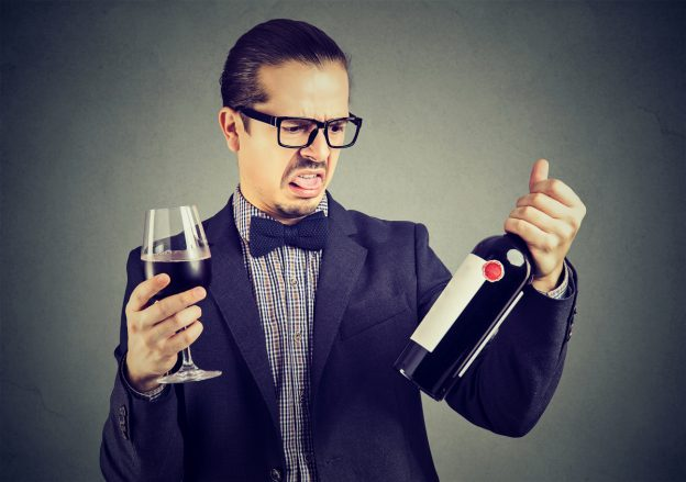 man-disgusted-by-red-wine-ingredients